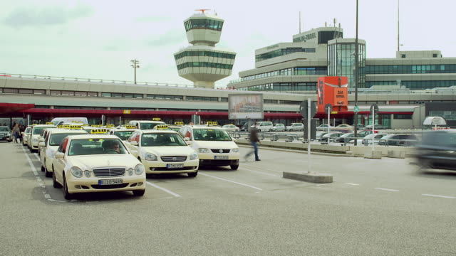 WS ZO T/L Taxis and people in front of Tegel Airport / Berlin, Germany