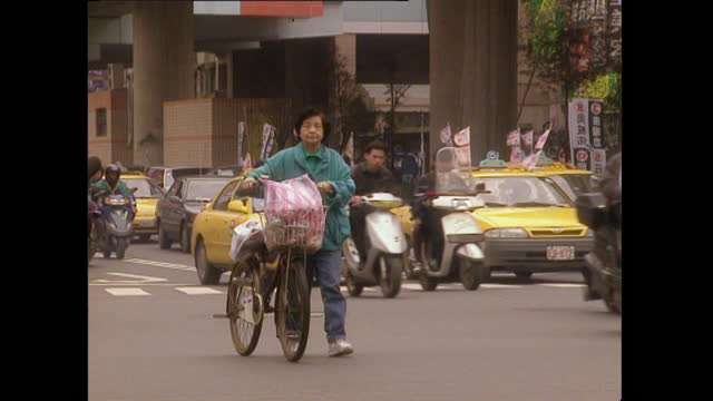 taxis, cars and mopeds on busy city street in taiwan; 1996 - taipei stock videos & royalty-free footage