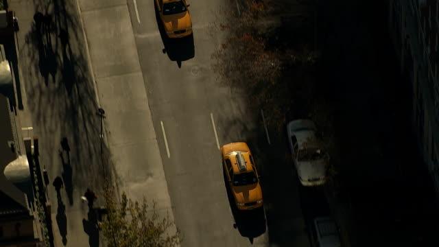 taxis move through traffic on a manhattan street. - manhattan video stock e b–roll