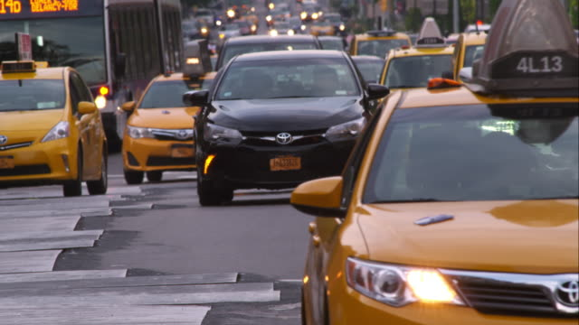 taxis on 1st avenue - yellow taxi stock-videos und b-roll-filmmaterial