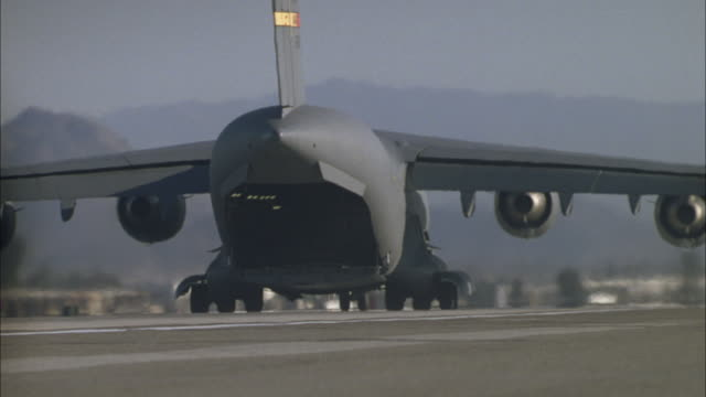 a c-17 taxis on a runway. - us airforce stock videos & royalty-free footage