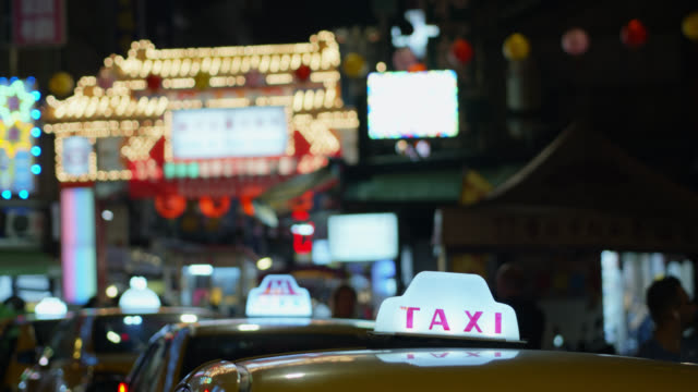 taxis outside raohe night market - taipei stock videos & royalty-free footage
