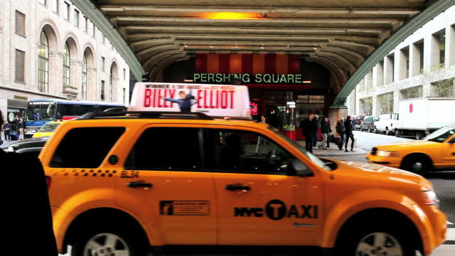 MS Taxis passingfrom in front of grand central station  / New York, United States