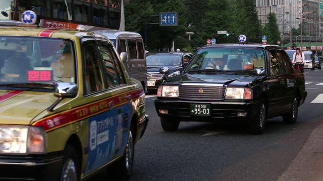 taxis wait in line at a taxi stand outside a train station in tokyo japan on monday july 11 2016 - taxi stand stock videos and b-roll footage