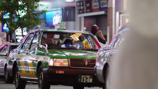 MS Taxis waiting for passengers in Shinjuku Dori / Tokyo, Tokyo-to, Japan