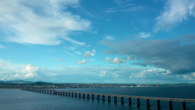 tay rail bridge over estuary, dundee, scotland, uk - dundee scotland stock videos and b-roll footage