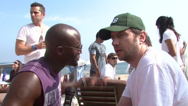 Taye Diggs and Jamie Kennedy on Malubu the Poloroid Beach House and the camera at the Boost Mobile BBQ at Polaroid Beach House in Malibu California...