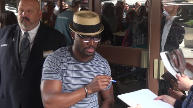 Taye Diggs signs for fans outside of The Theater at Madison Square Garden for the TNTTBS Upfront in Celebrity Sightings in New York