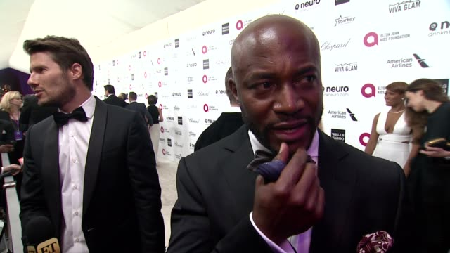vídeos de stock, filmes e b-roll de interview taye diggs what brings him out talks about elton's commitment to the ejaf his thoughts on the oscar ceremony and what he thought about john... - festa do oscar