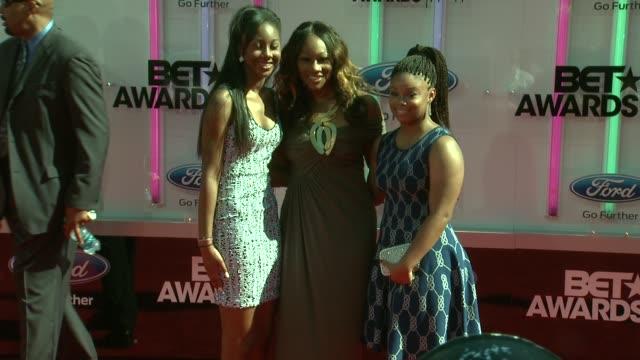 Taylor Ayanna Crawford and Yolanda Adams at the 2014 BET Awards on June 29 2014 in Los Angeles California