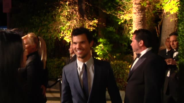 taylor lautner at the 2013 vanity fair oscar party hosted by graydon carter taylor lautner at the 2013 vanity fair oscar party at sunset tower on... - oscar party stock videos & royalty-free footage