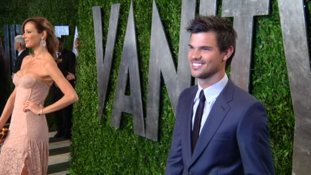 taylor lautner at the 2013 vanity fair oscar party hosted by graydon carter taylor lautner at the 2013 vanity fair oscar party at sunset tower on... - vanity fair oscar party stock videos & royalty-free footage