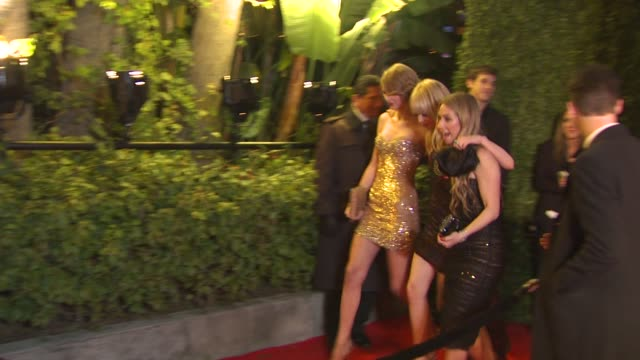Taylor Swift and Emma Stone at at the 2011 Vanity Fair Oscar Party Arrivals at Hollywood CA