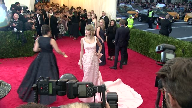 """taylor swift at """"charles james: beyond fashion"""" costume institute gala - arrivals at the metropolitan museum on may 05, 2014 in new york city. - matte image technique stock videos & royalty-free footage"""