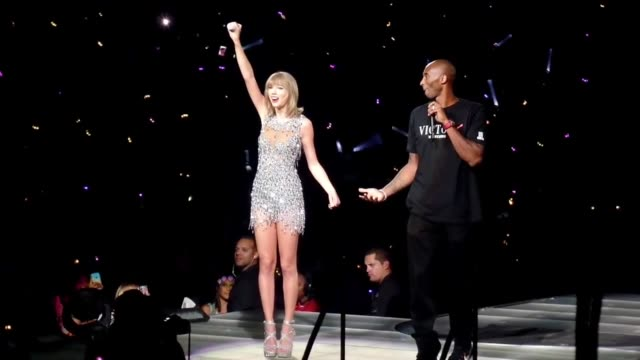 taylor swift gets presented a banner by kobe bryant at staples center in los angeles in celebrity sightings in los angeles - kobe bryant stock videos & royalty-free footage