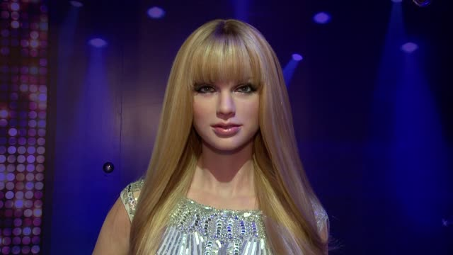 taylor swift wax figure - adele wax figure unveiling at madame tussaud's at madame tussauds on february 19, 2014 in new york city. - madame tussauds stock videos & royalty-free footage