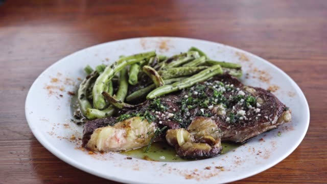 t-bone steak with grilled green beans - food styling stock videos & royalty-free footage