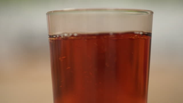 tea being poured into glass mug and milk added - tea cup stock videos & royalty-free footage