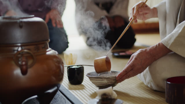 tea ceremony host preparing tea while guests eat - japanese culture stock videos & royalty-free footage