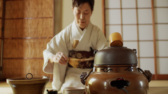 tea ceremony host rinsing tea whisk - ceremony stock videos & royalty-free footage