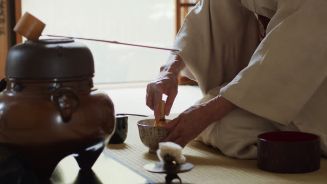 tea ceremony host whisking tea in bowl - kimono stock videos & royalty-free footage