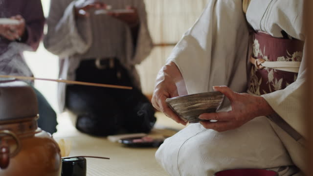 tea ceremony host wiping rim of bowl - kimono stock videos & royalty-free footage
