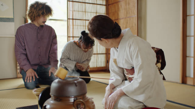 tea ceremony hostess demonstrating how to handle bowl and bow - washitsu stock videos and b-roll footage