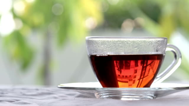 tea, crystal cup of hot beverage with steam - tea hot drink stock videos & royalty-free footage