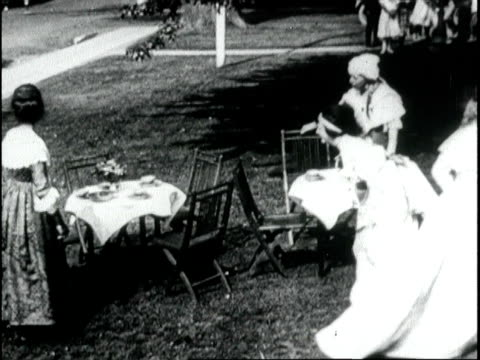 'tea gown a century old bring funds to red cross' / society women raise money for war needs, sit down to tea and are served by nurses in uniform.... - 1918 stock videos & royalty-free footage