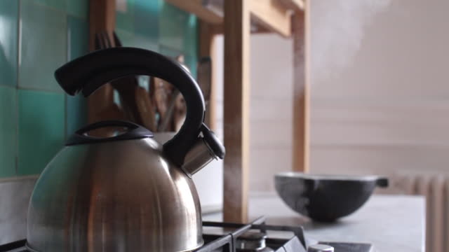tea kettle emitting steam - kettle stock videos & royalty-free footage