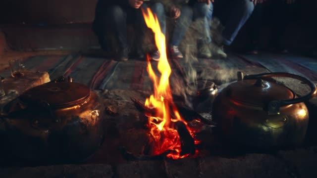 tea kettle on campfire in wadi rum desert  at night - tea kettle stock videos & royalty-free footage