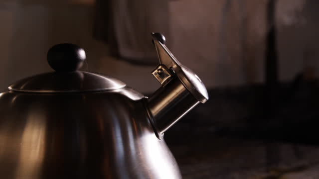 tea kettle steaming - kettle stock videos & royalty-free footage