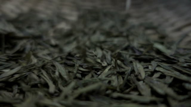 tea leaves falling - dried tea leaves stock videos & royalty-free footage