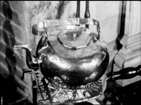 tea pot on trivet. top of grandfather clock, 9:25. - 大時計点の映像素材/bロール