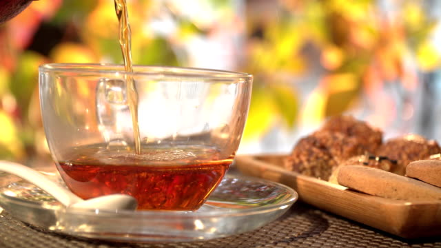 tea pour in glass on a cafe - tea stock videos and b-roll footage