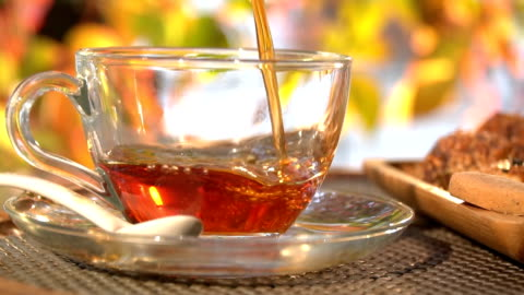 tea pour in glass on a cafe - hot drink stock videos & royalty-free footage