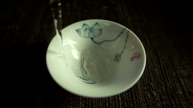 tea pouring into cup - porcelain stock videos & royalty-free footage