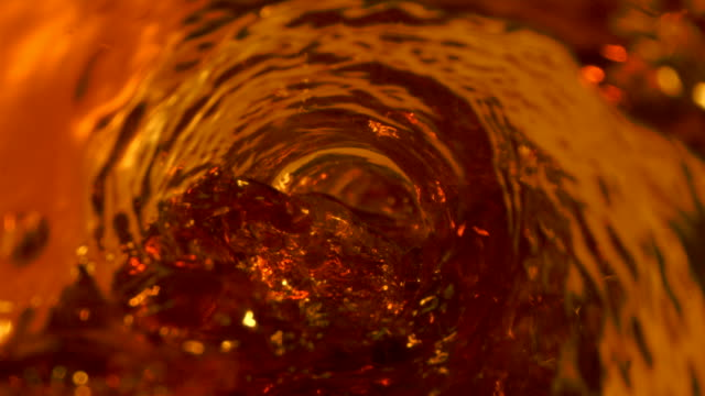 tea pouring with swirl whirlpool in the glass - antioxidant stock videos & royalty-free footage