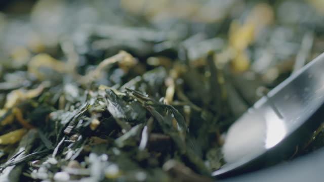 tea scoop - dried tea leaves stock videos & royalty-free footage