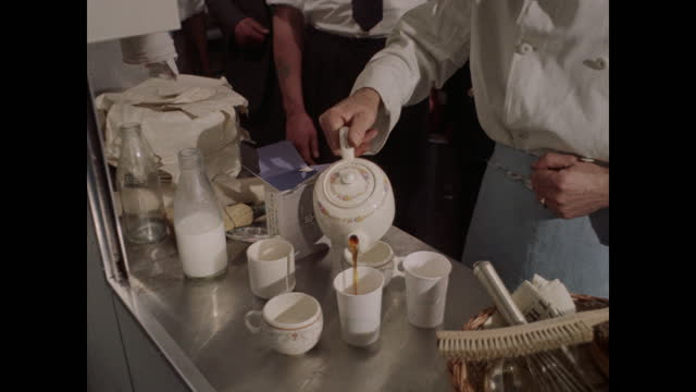 1960 - tea service montage, united kingdom - archival stock videos & royalty-free footage