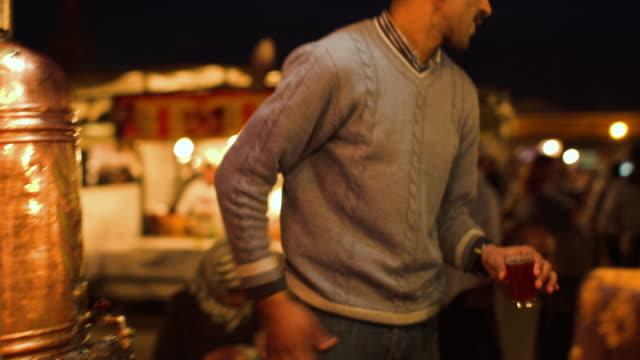 tea vendor at jemaa el fna. - moroccan culture stock videos & royalty-free footage