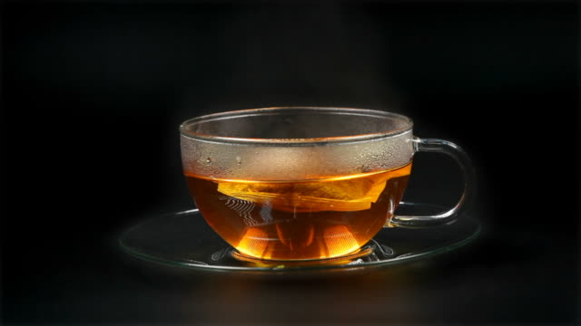 tea with a teabag - isolated - tea cup stock videos and b-roll footage