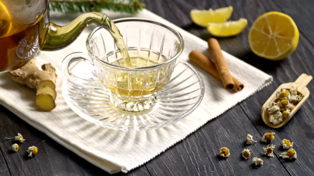 tea with ginger, lemon. slow motion. - ginger spice stock videos and b-roll footage