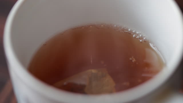 teabag in mug - tea cup stock videos & royalty-free footage