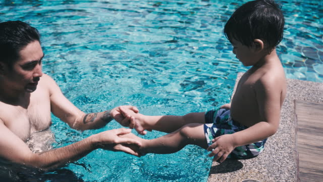 teach children to swim in the pool - 1956 stock videos & royalty-free footage