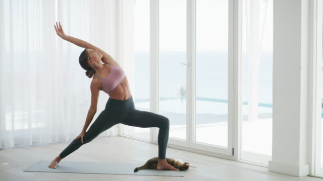 teach your body to relax with yoga - pilates stock videos & royalty-free footage