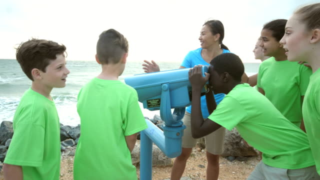 teacher and children on field trip to coastline - 12 13 years stock videos & royalty-free footage