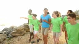 Teacher and children on field trip to coastline
