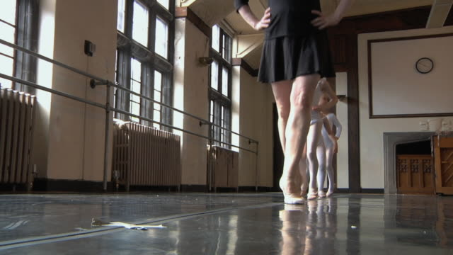 stockvideo's en b-roll-footage met ms slo mo teacher and her students (4-7) march in line in ballet studio / chicago, illinois, usa - gympak