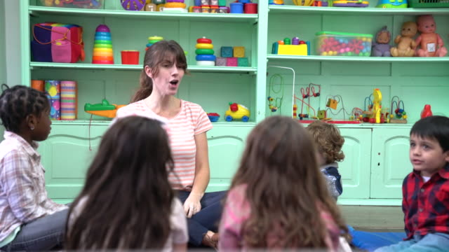 teacher and preschool kids clapping in classroom - preschool stock videos & royalty-free footage